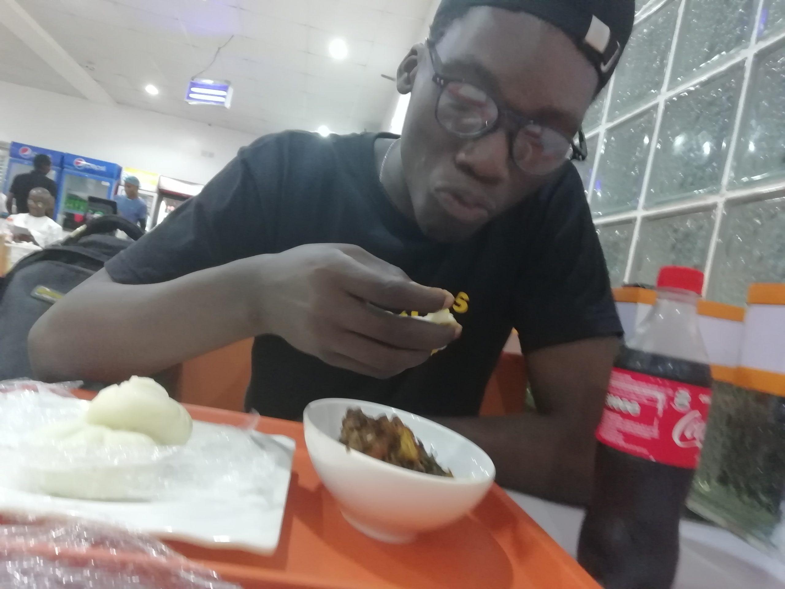 man eating pounded yam